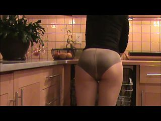 in pantyhose in the kitchen