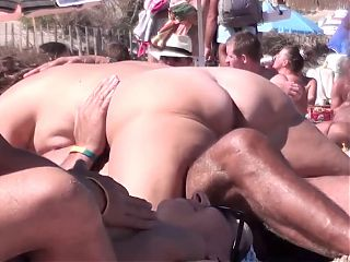 French nudist beach Cap d'Agde hot brunette sucking fucking