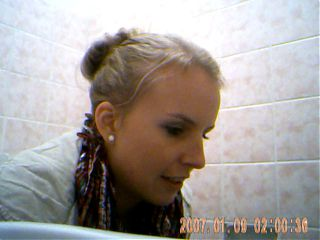 Hot young girl at party on toilet