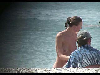 Voyeur on public beach