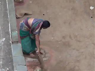Aunty sweeping voyeur
