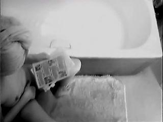 Small titted girl wanks on toilet-hidden