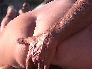 French nudist beach Cap d'Agde spread legs finger pussy