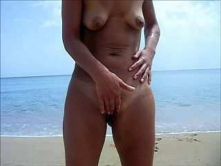 girl on beach standing and wanking