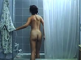 Blind Asian Woman takes a shower