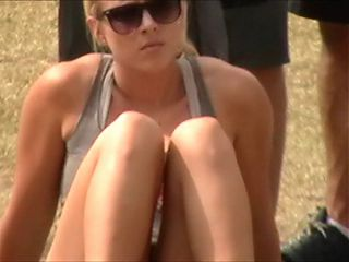 Blonde Fit Chick Sitting and Watching